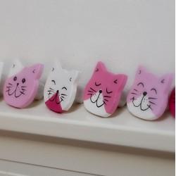 Knopky na nábytek kočky
